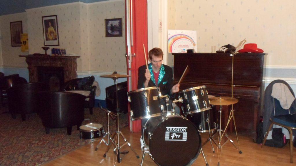 Jonathan playing drums